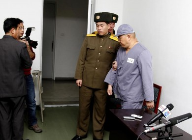 File pic: American missionary Kenneth Bae, right, leaves after speaking to reporters at Pyongyang Friendship Hospital in Pyongyang (January).