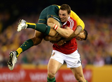 George North making light work of an Israel Folau tackle in the second Lions Test last year.