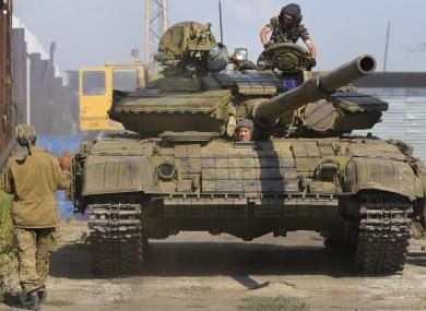 A file photo pro-Russian rebels in a tank.