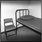 Cell bed and chair at the RUC station.<span class=