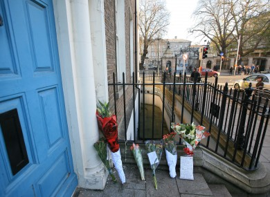 Flowers left for Jonathan Corrie in the doorway in which he passed away yesterday.
