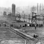 Part of the Auschwitz war crimes court inspects the former Nazi extermination center in Poland in Dec. 1964.<span class=