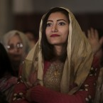 An Egyptian Coptic Christian listens during Christmas Eve Mass at St. Mark's Cathedral, in Cairo, Egyp. The Coptic Christian population are considered to be the largest Christian community in the Middle East and observe Christmas on January 7 according to the old, Julian calendar. (AP Photo/Nariman El-Mofty)<span class=
