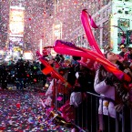 Revelers are engulfed by confetti in Times Square<span class=