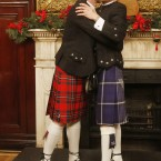 Malcolm Brown (left) and Joe Schofield, both 42, kiss after tying the knot in The Trades Hall, Glasgow, in one of Scotland's first same-sex weddings (2014).<span class=