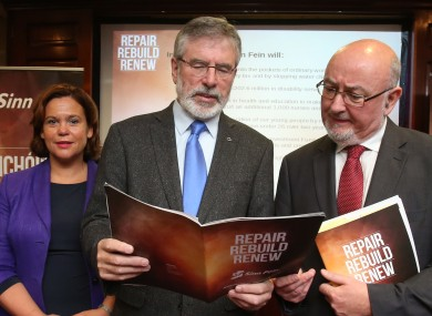 Sinn Féin leader Gerry Adams and colleagues examine the party's latest pre-budget submission