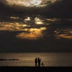A couple take photos with a phone as the sun rises in front of the Mediterranean Sea in Barcelona, Spain, Wednesday, Jan. 21, 2015. <span class=