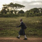 A Tanzanian girl smiles as she makes her way back from school in Arusha, eastern Tanzania, Thursday, Jan. 15, 2015. The city is close to national parks including Serengeti and Kilimanjaro. (AP Photo/Mosa'ab Elshamy)<span class=