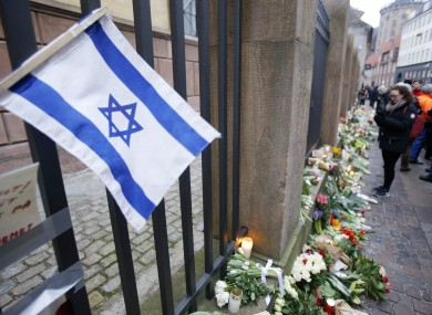 A Israeli flag is fixed to the fence of a synagogue where one person was killed in Copenhagen.