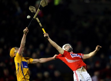 Clare's Cian Dillon and Cork's Luke O'Farrell in opposition.
