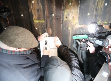 Receivers nail court order to the gates of the O'Donnell home in Killiney.
