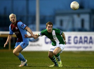Sean Thornton fights for the ball in the season opener against Bray.