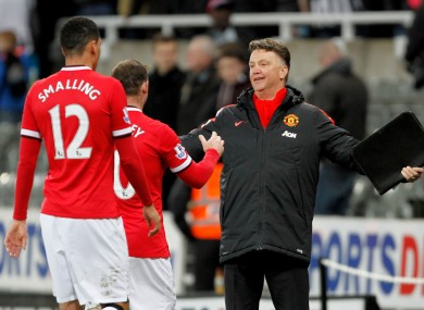 Manchester United manager Louis van Gaal celebrates a vital win with Wayne Rooney and Chris Smalling.