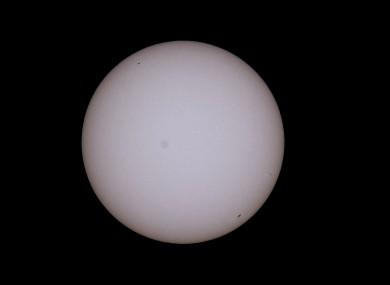 A solar eclipse as viewed through a solar filter.