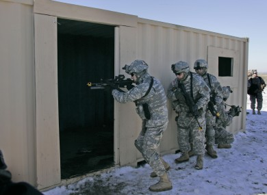 File: Soldiers from the 1st Infantry Division train in a mock Iraqi village at Fort Riley