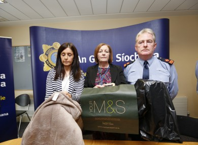 Sergeant Maeve O'Sullivan, Rita Byrne, Principal Social Worker with the Child and Family Agency, Tusla and Superintendent Brendan Connolly holding replica objects in which the baby was left.