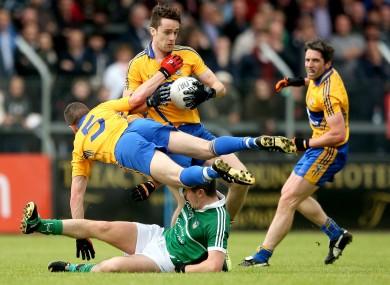 Clare's Shane Brennan and Shane Hickey with John Riordan of Limerick.