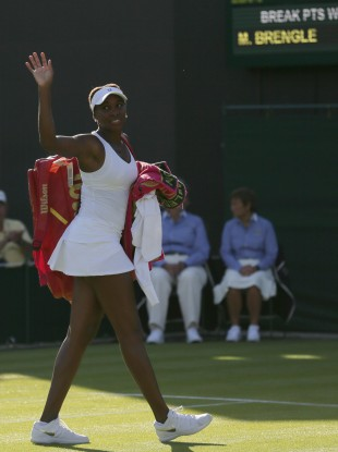 Venus Williams of the United States waves after defeating Madison Brengle of the United States.