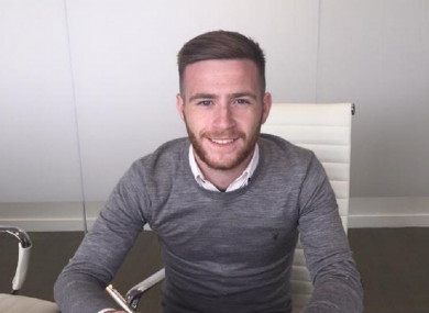 Byrne pictured signing his new contract.