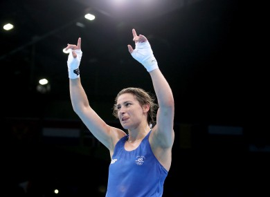 Ireland's Katie Taylor celebrates victory against Estelle Mossely of France.
