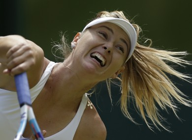 Maria Sharapova of Russia returns a ball to Coco Vandeweghe of the United States during their singles match.