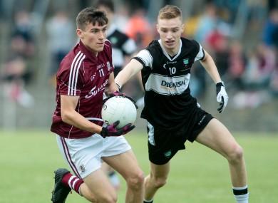 Galway's Finnian Ó Laoi is pursued by Liam Gaughan of Sligo.