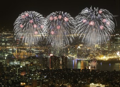 Macy's Fourth of July fireworks light up the sky over the East River in New York in a view from One World Observatory.