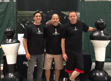 Hartigan, left, with members of the Shadowman Sports team.