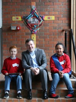 Parish priest Sean Duggan with students Jack Rooney (9) and Sinead Delambaca (12) at the launch of Catholic Schools Week.