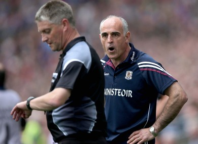 Galway boss Anthony Cunningham with referee Barry Kelly during Sunday's game.