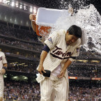 Kurt Suzuki of the Minnesota Twins gets doused in Gatorade after his winning RBI-single against the Seattle Mariners.