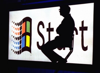 Then Microsoft chairman Bill Gates sitting in front of the now-iconic Start button during Windows 95's launch event.