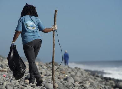 A Municipal worker searches Reunion Island beaches last week.