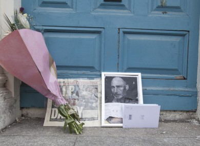 Flowers in the doorway where homeless man Jonathan Corrie died in December of last year.