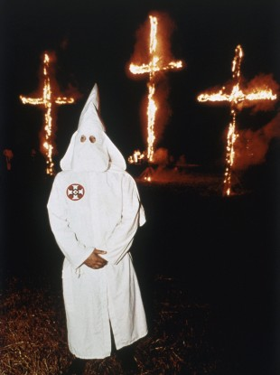 File photo of a Ku Klux Klan cross burning.