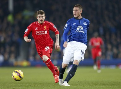 Everton and Ireland midfielder with Liverpool's Alberto Moreno.
