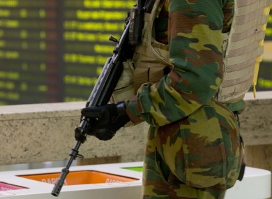 A Belgian Army soldier patrols the central train station in Brussels today.
