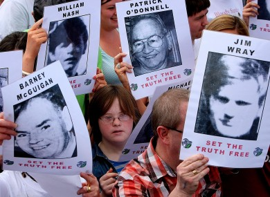The crowd carry pictures of the victims of Bloody Sunday while they march through Derry in 2010.