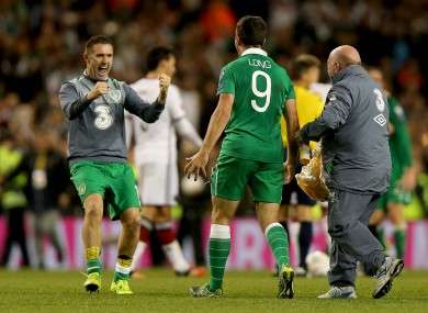 Ya beauty! Keane celebrates with goal hero Shane Long after Ireland's win against Germany.