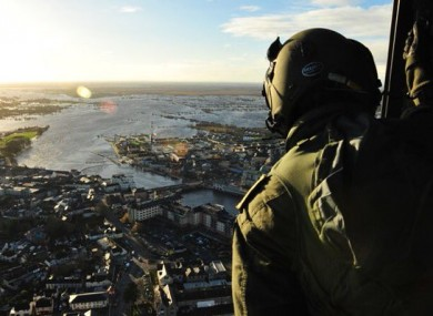 An member of the Irish Air Corps surveys the scene above Athlone
