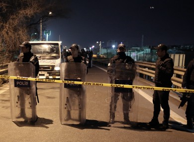 Riot police secure the area after yesterday's explosion.