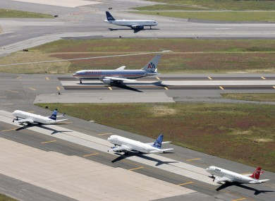 file photo, planes taxi on runways at John F. Kennedy International Airport in New York.