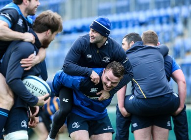 Peter Dooley gives Dave Kearney a bit of a lift.
