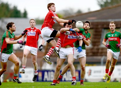 Ian Maguire rises high at midfield for Cork against Mayo today.