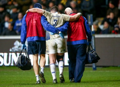 Marty Moore is helped off the field at the weekend.