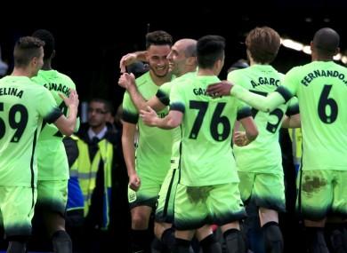 Manchester City players celebrate David Faupala's goal.