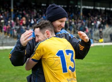 Roscommon boss Fergal O'Donnell celebrates victory with attacker Ciaran Murtagh.