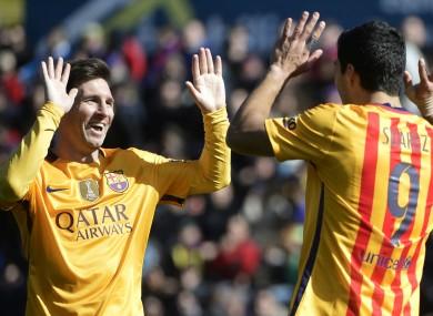 Barcelona team-mates Lionel Messi and Luis Suarez.