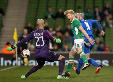 Ireland goalkeeper Darren Randolph is beaten as Paul McShane turns the ball in to his own net.