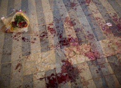 Blood stains the street at the scene of a stabbing attack in Jaffa, a mixed Jewish-Arab part of Tel Aviv.